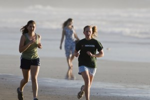 Two girls jogging on the beach