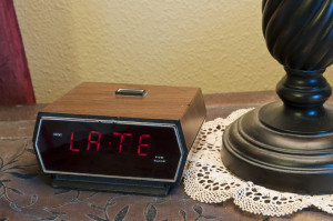 "image of clock saying ""LATE"""